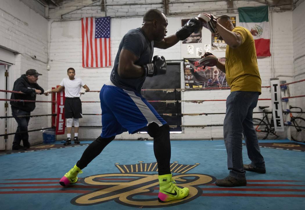 Heavyweight boxer Rubens Nicolas, left, boxes with private trainer Eddie Sanchez, right, on Fri ...