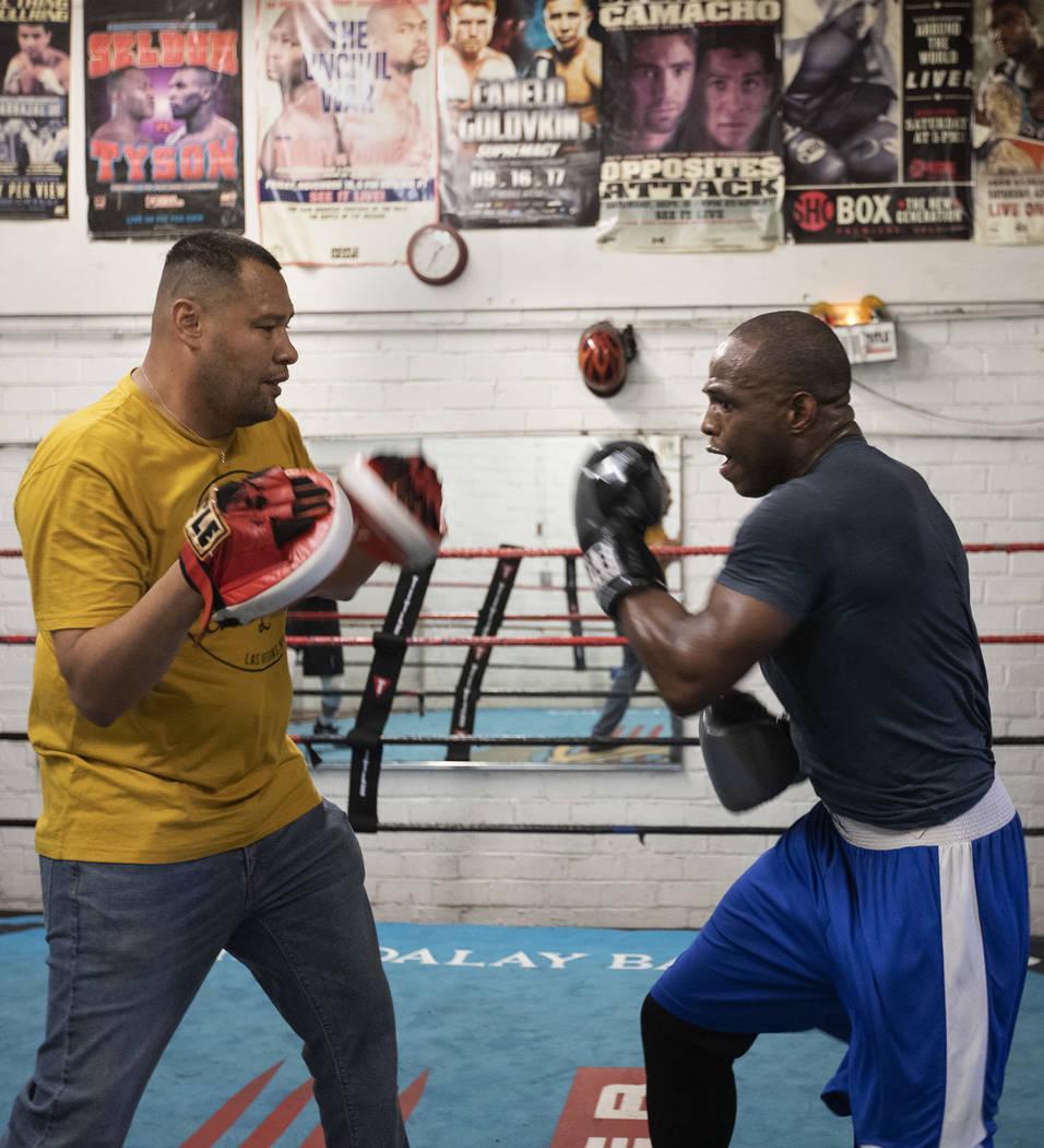 Heavyweight boxer Rubens Nicolas, right, boxes with private trainer Eddie Sanchez, left, on Fri ...