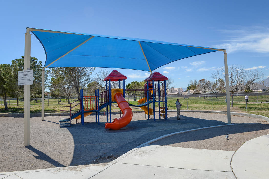 Residents enjoy a sunny afternoon at Woofter Park in Las Vegas, Monday, March 18, 2019. (Caroli ...