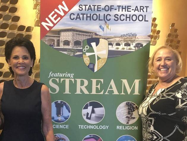 From left, Cathy Thompson, superintendent of schools for the Roman Catholic Diocese of Las Vega ...