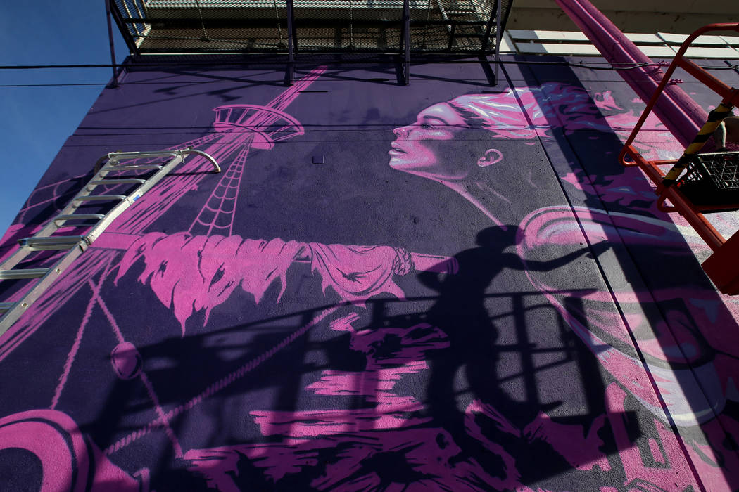"Unidentified crew members paint the mural ""Mermaids Don't Wear Skirts,"" a collaborati ..."