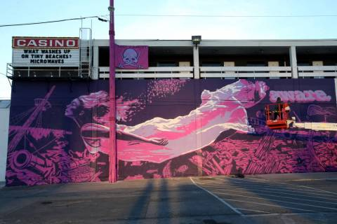 """Unidentified crew members paint the mural """"Mermaids Don't Wear Skirts,"""" a collaborati ..."""