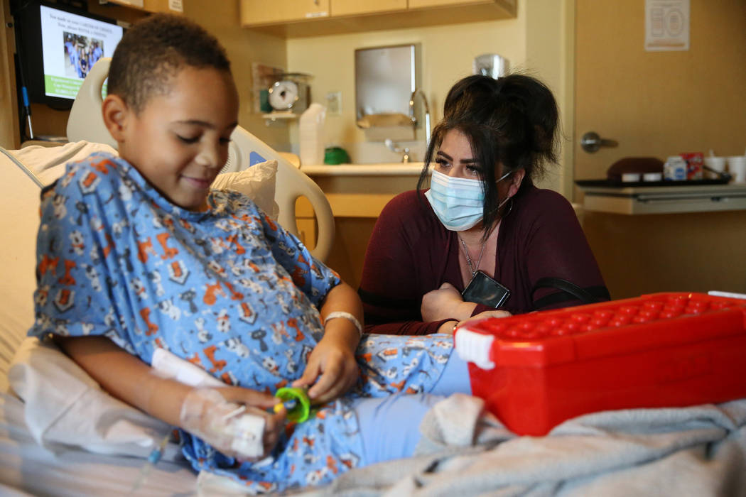 Hanna Olivas, founder of Brave and Beautiful Project, talks Jashon Bible, 7, after helping Sant ...