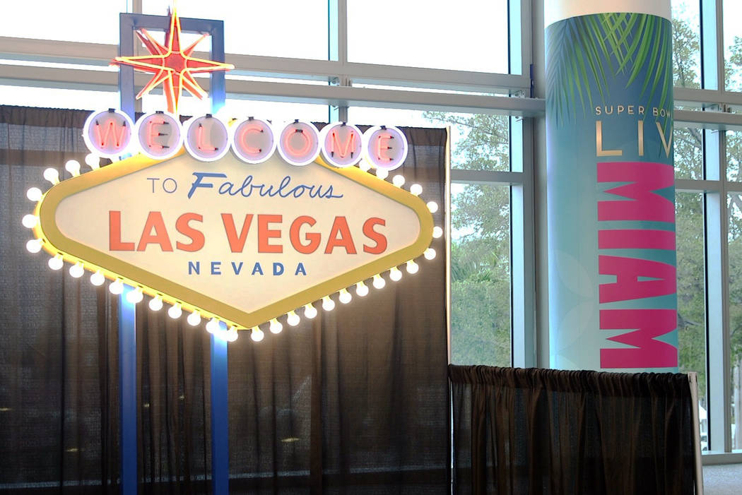 A replica of the Welcome to Las Vegas sign on display at the NFL Experience at the Miami Beach ...