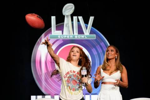 NFL Super Bowl 54 football game halftime performer Jennifer Lopez and Shakira throws a football ...