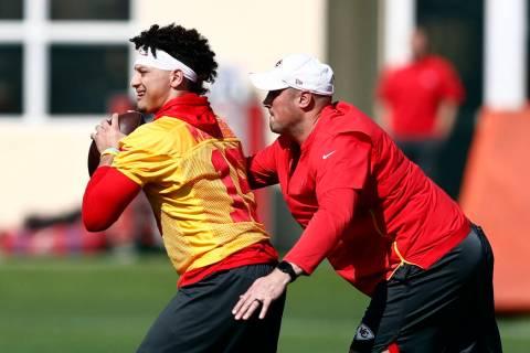 Kansas City Chiefs quarterback Patrick Mahomes (15) runs drills with coach Mike Kafka during pr ...