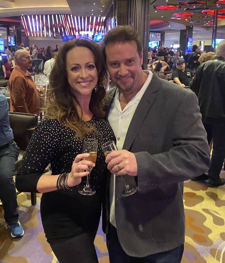Drew and J.J. Combs, Hard Rock Hotel employees since the hotel opened in 1995, are shown at the ...