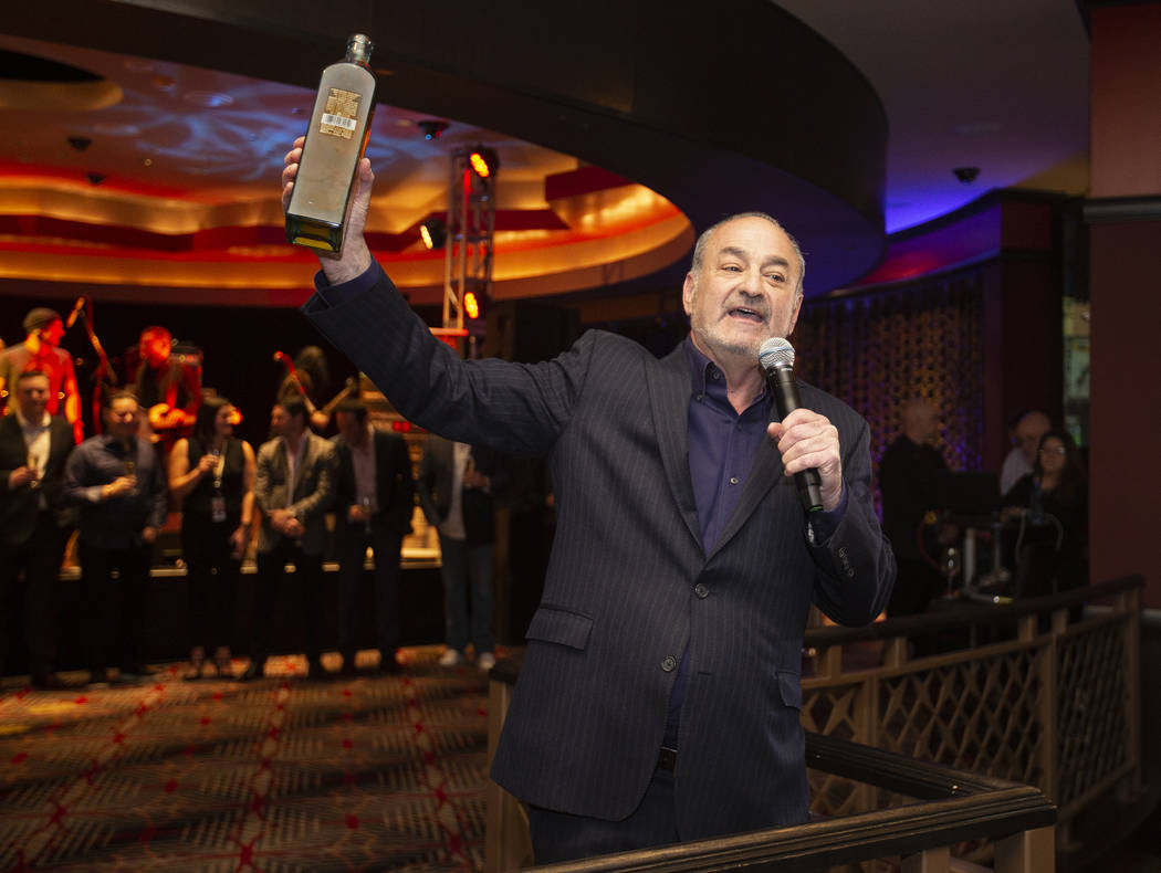"""Hard Rock Hotel CEO Richard """"Boz"""" Bosworth toasts the crowd during an event to sa ..."""