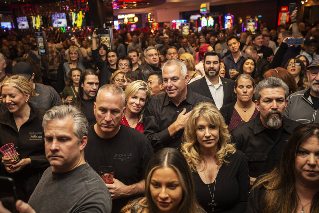 A large crowd gathers to listen to the All Request Live band during an event to say goodbye to ...