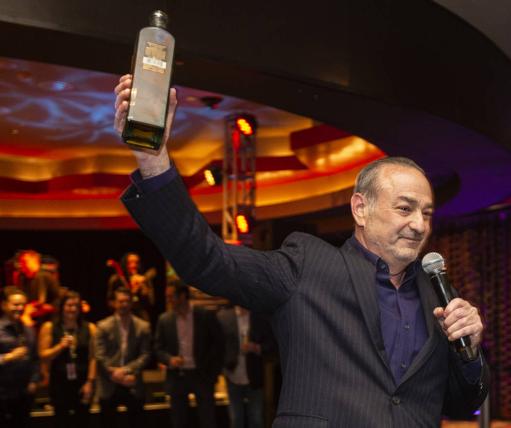 """Hard Rock Hotel CEO Richard """"Boz"""" Bosworth toasts the crowd during an event to say goodbye ..."""