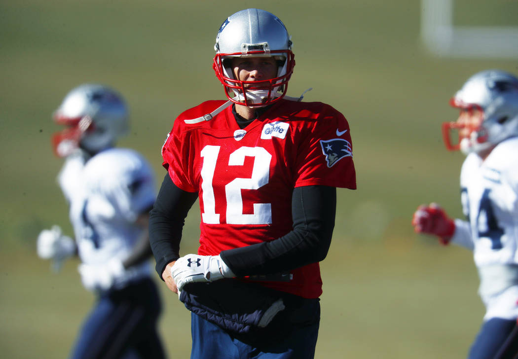 New England Patriots quarterback Tom Brady takes part in drills before practicing Wednesday, No ...
