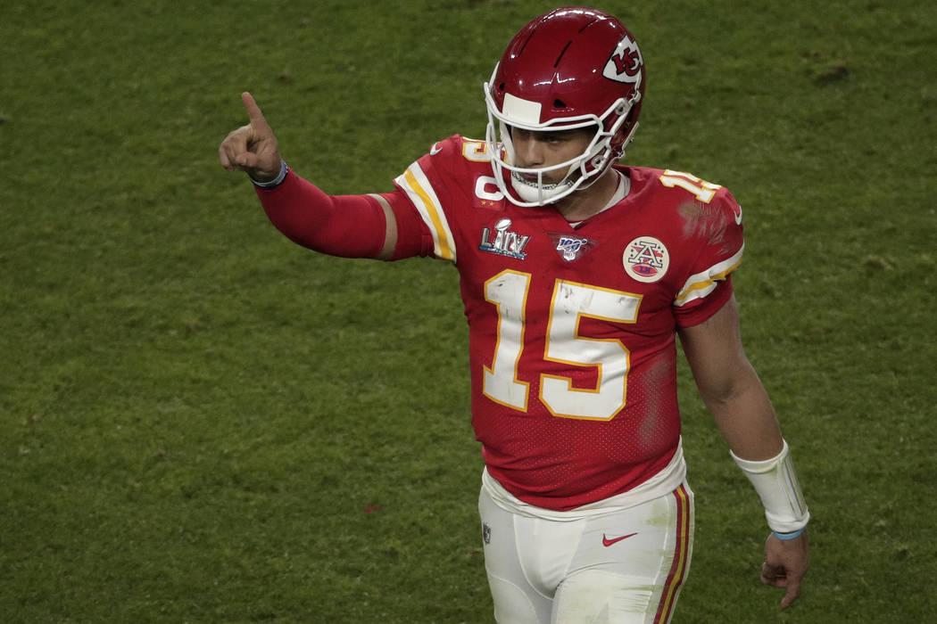Kansas City Chiefs quarterback Patrick Mahomes (15) gestures after Damien Williams scores his s ...