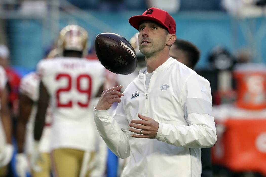 San Francisco 49ers head coach Kyle Shanahan watches during as the team warms up before the NFL ...