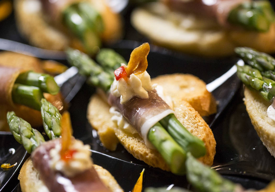 Asparagus wrapped in prosciutto appetizers during the 44th Annual UNLVino fundraiser at the Kee ...