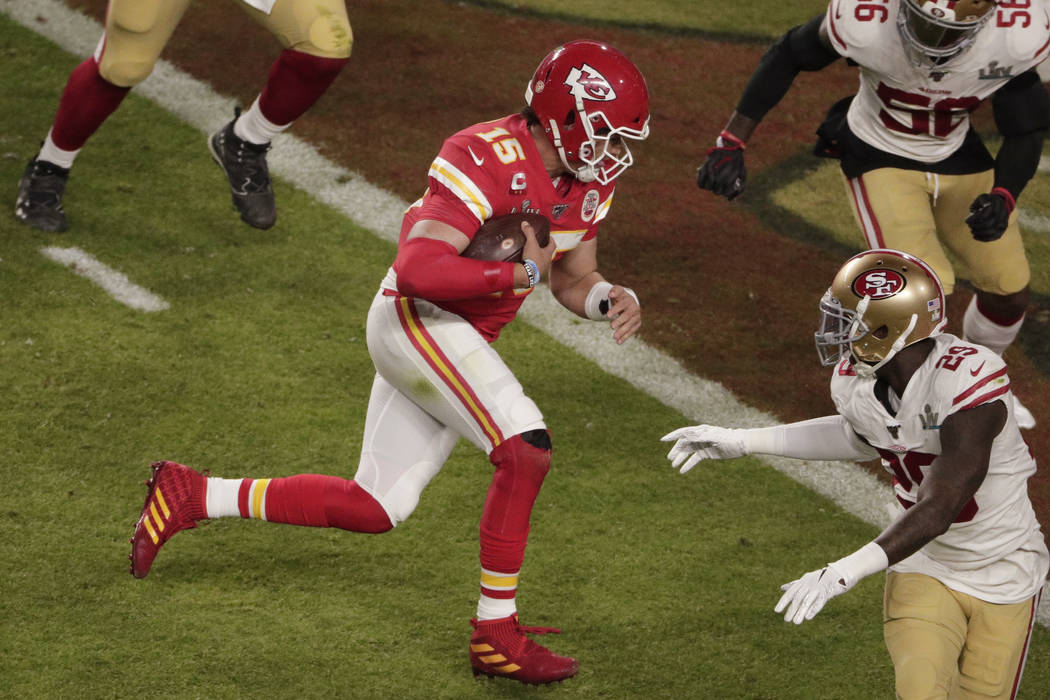 Kansas City Chiefs quarterback Patrick Mahomes (15) runs for a touchdown, during the first half ...