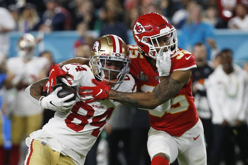 San Francisco 49ers' Kendrick Bourne (84) runs against Kansas City Chiefs' Charvarius Ward (35) ...