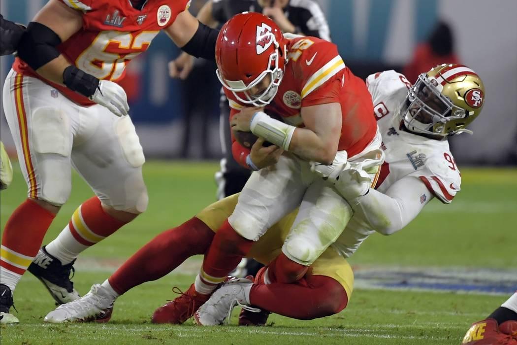 San Francisco 49ers' DeForest Buckner, right, sacks Kansas City Chiefs' quarterback Patrick Mah ...