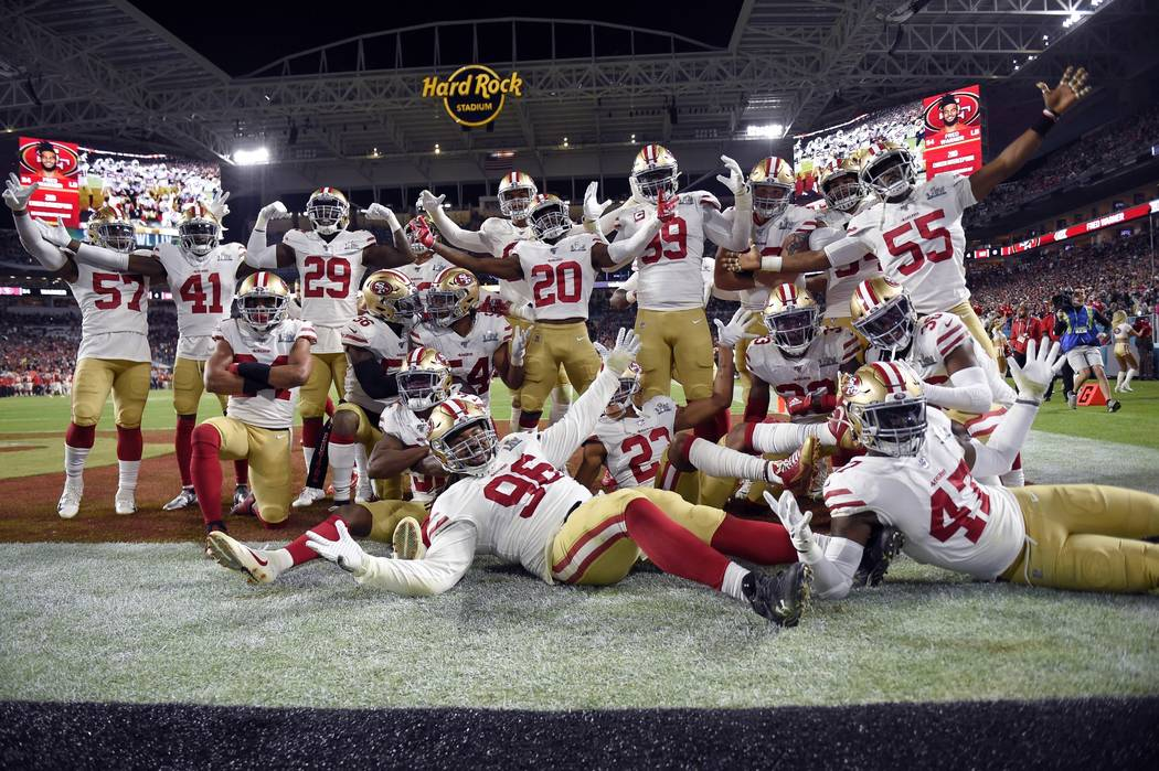 San Francisco 49ers' Fred Warner (54) and teammates celebrate his interception against the Kans ...