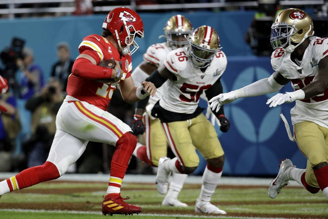 Kansas City Chiefs quarterback Patrick Mahomes runs for a touchdown against the San Francisco 4 ...