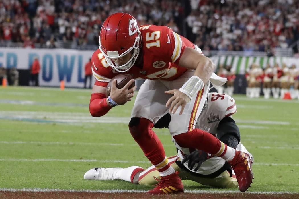 Kansas City Chiefs quarterback Patrick Mahomes (15) runs into the end zone for a touchdown agai ...