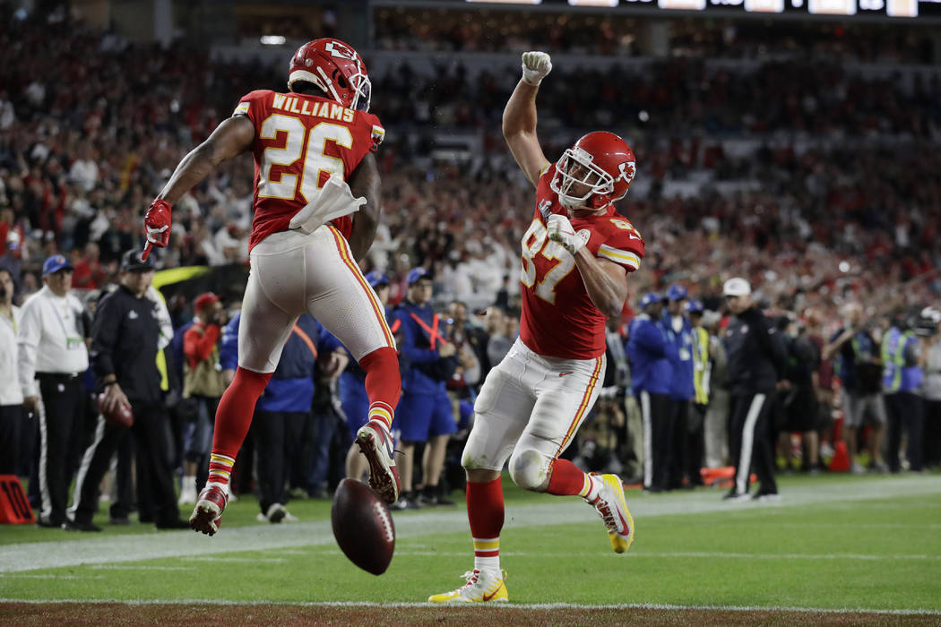 Kansas City Chiefs' Travis Kelce (87) celebrates his touchdown with Kansas City Chiefs' Damien ...