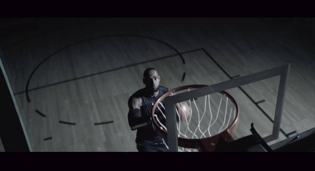 This undated image provided by GMC shows Los Angeles Lakers forward LeBron James in a scene fro ...