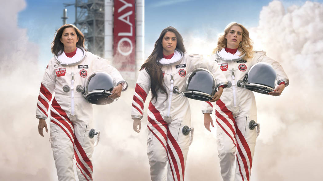 This undated image provided by Olay shows from left, retired astronaut Nicole Stott, Lilly Sing ...