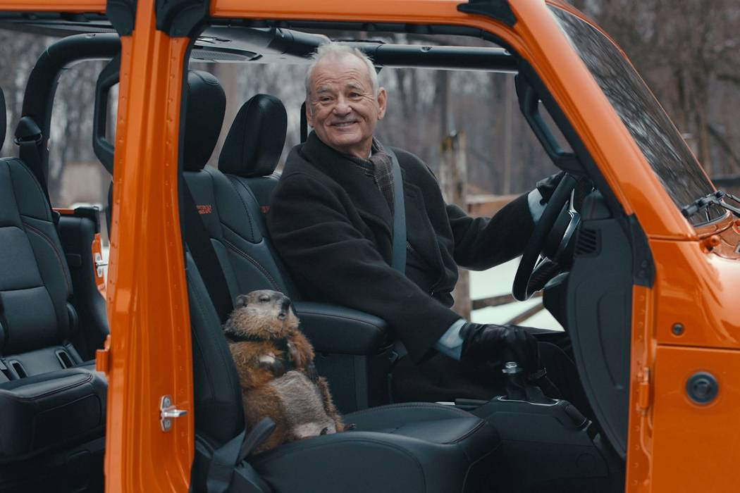 This undated image provided by Jeep shows Bill Murray reprises his role as Phil Connors from th ...
