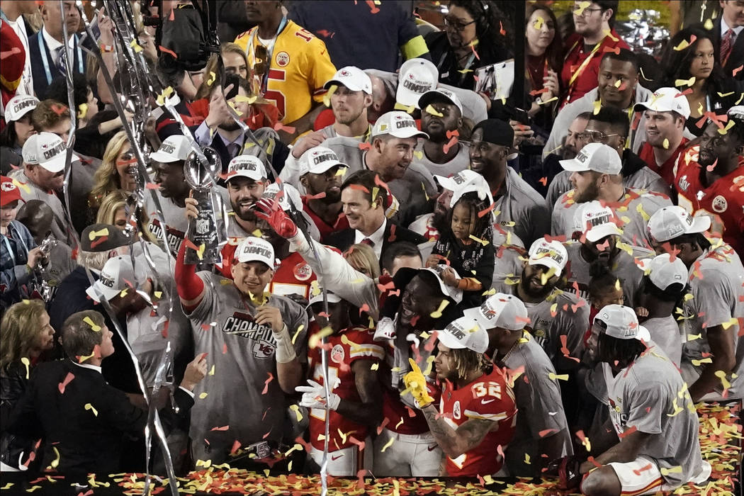 Kansas City Chiefs quarterback Patrick Mahomes holds the Vince Lombardi trophy, after his team ...