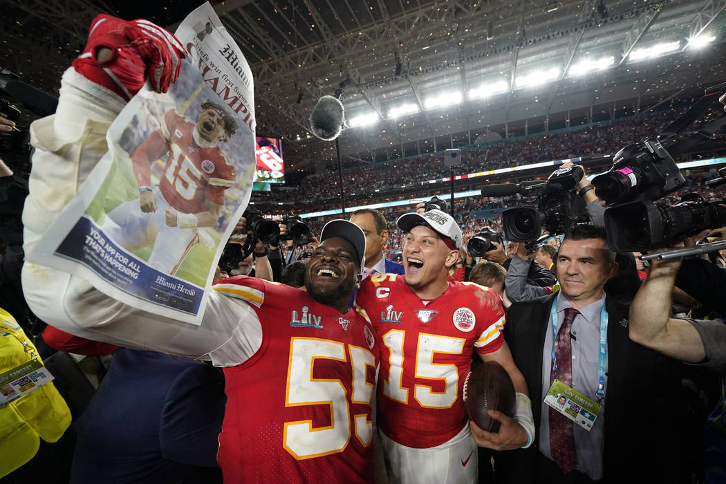Kansas City Chiefs' Frank Clark, left, and Patrick Mahomes celebrate after defeating the San Fr ...