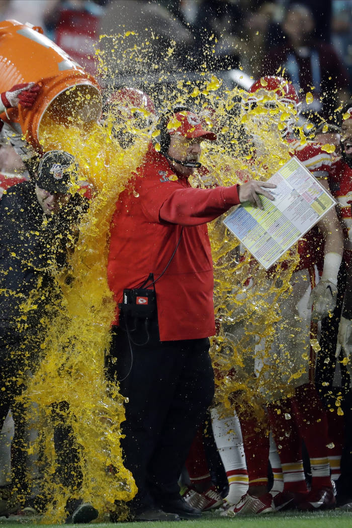 Kansas City Chiefs head coach Andy Reid is doused on the sideline during the second half of the ...