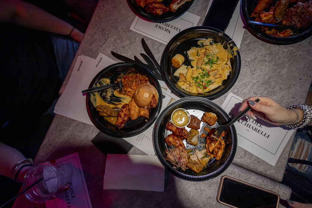 People eat while attending a Super Bowl watch party at the HyperX Esports Arena Las Vegas at th ...