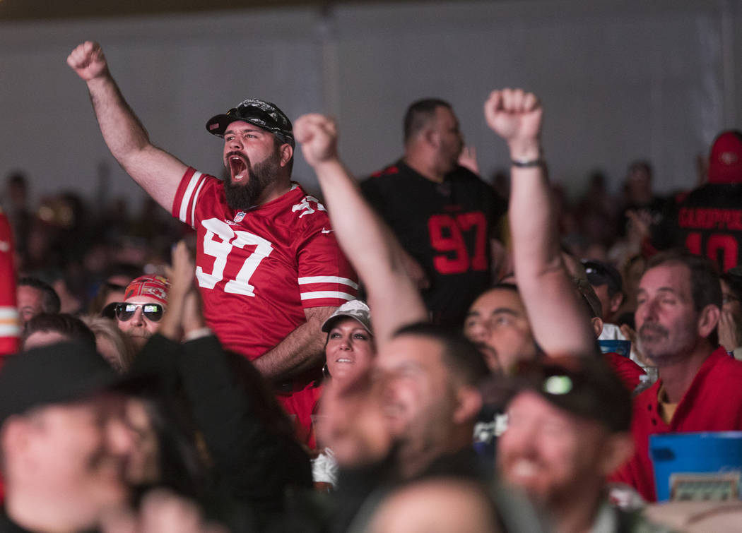 The crowd cheers at a watch party for Super Bowl LIV at the Downtown Las Vegas Events Center in ...