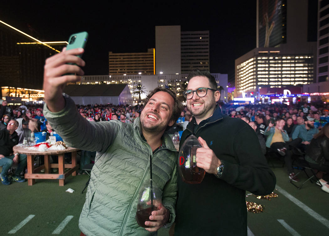 Paulo Penna, left, and Luigi Russo, right, both of Brazil, take a selfie at a watch party for t ...