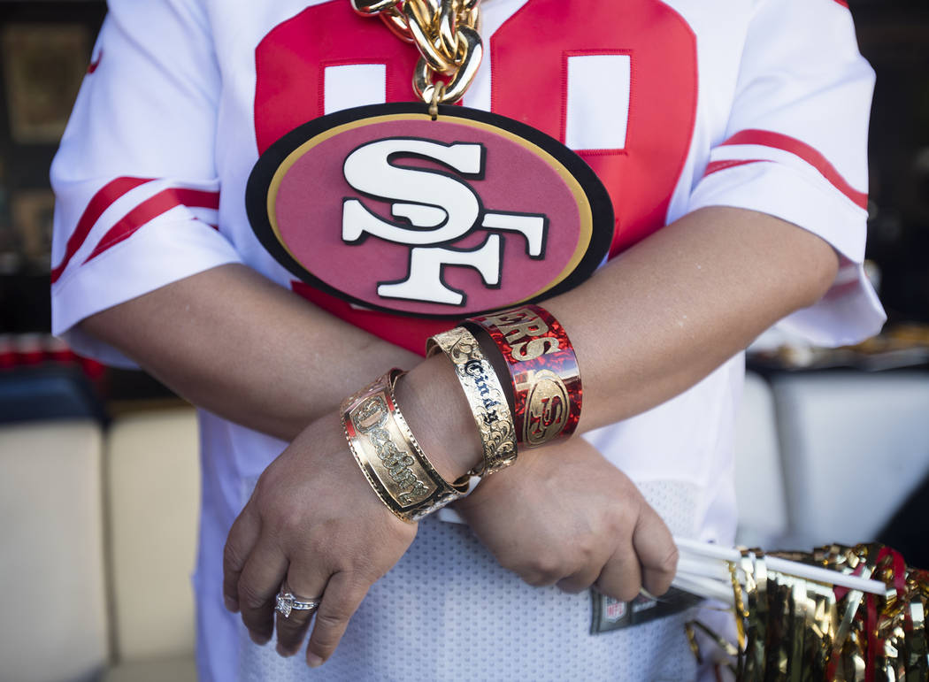 Sherry Lindsey, of Hawaii, shows off her 49ers accessories at a watch party for Super Bowl LIV ...