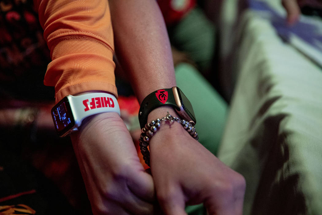Kansas City Chiefs' fans display their watch bands as they attend a watch party of the Super Bo ...