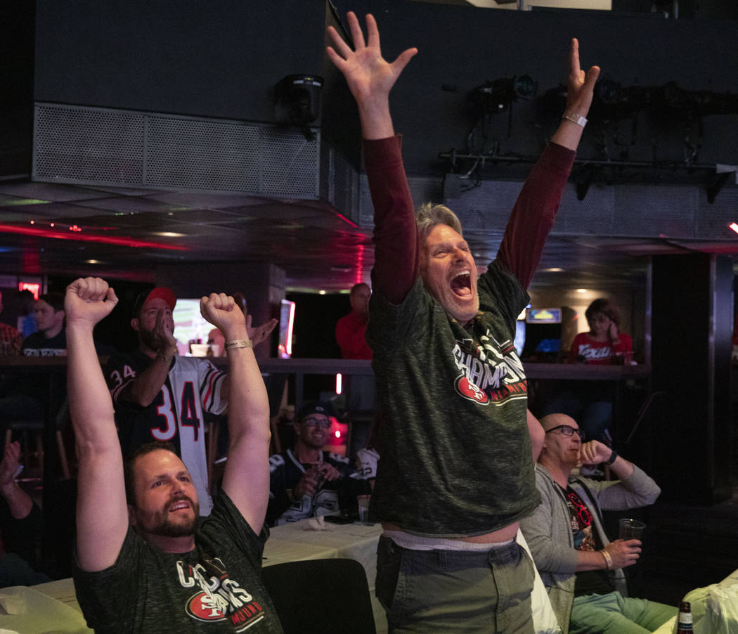 Matt Myers of Flagstaff, Arizona, left, and Michael Myers of Phoenix, Arizona, cheer for the Sa ...