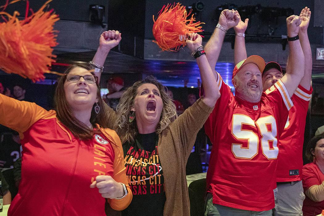 Kansas City Chiefs' fans Amy Teschner, left, Ashli Hanlan, center, and Mike Hanlen, of Kansas C ...