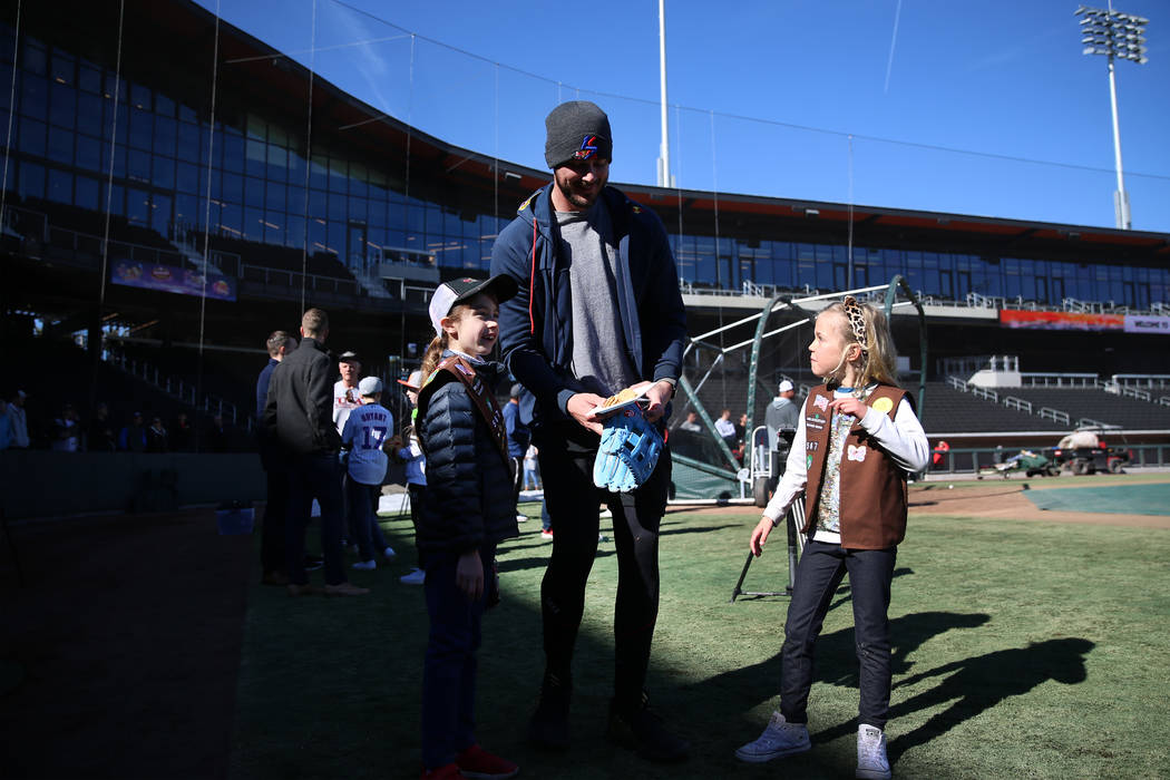 Chicago Cubs player Kris Bryant meets 7-year-olds Audrey Neal, left, and Audrey Shaw, of the Gi ...