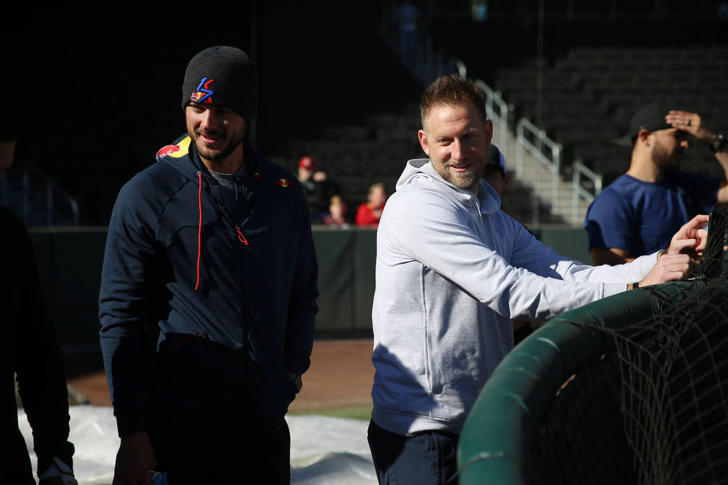 Chicago Cubs player Kris Bryant, left, and former professional player Tyler Wagner, attend a li ...