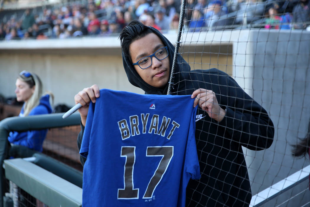 Marco Valdovinos, 15, of Las Vegas, waits for an autograph from Chicago Cubs player Kris Bryant ...