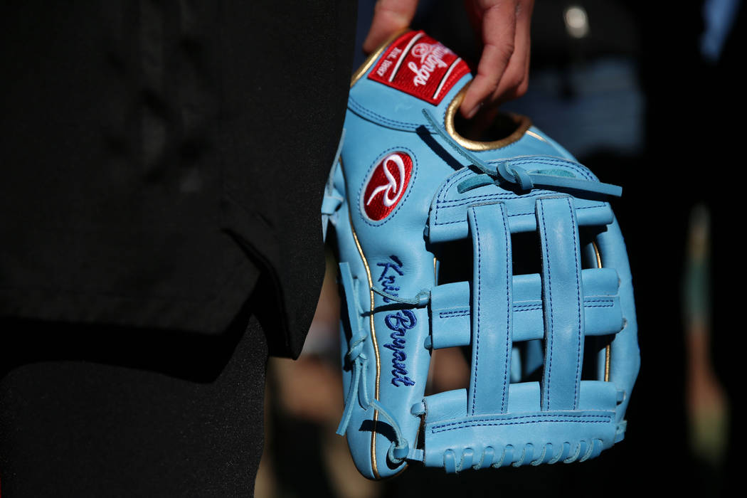 Chicago Cubs player Kris Bryant holds his glove while giving a press interview during a live ba ...