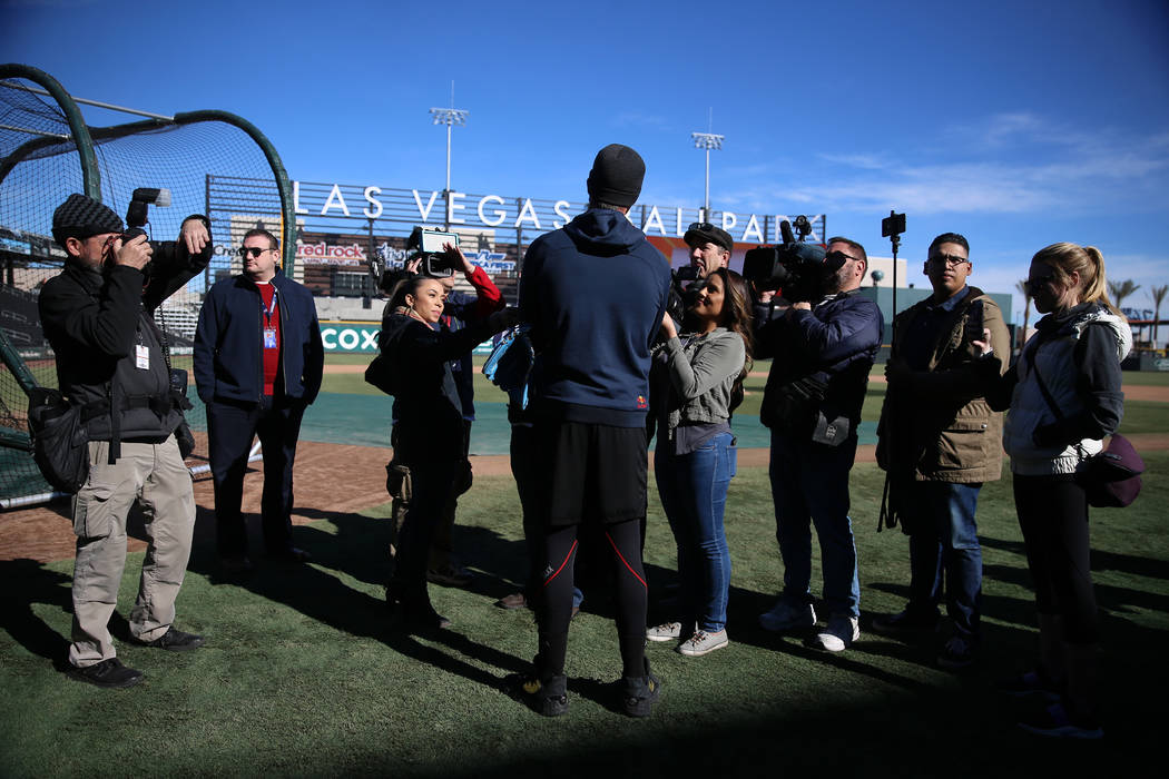 Chicago Cubs player Kris Bryant holds is interviewed during a live batting practice event at La ...