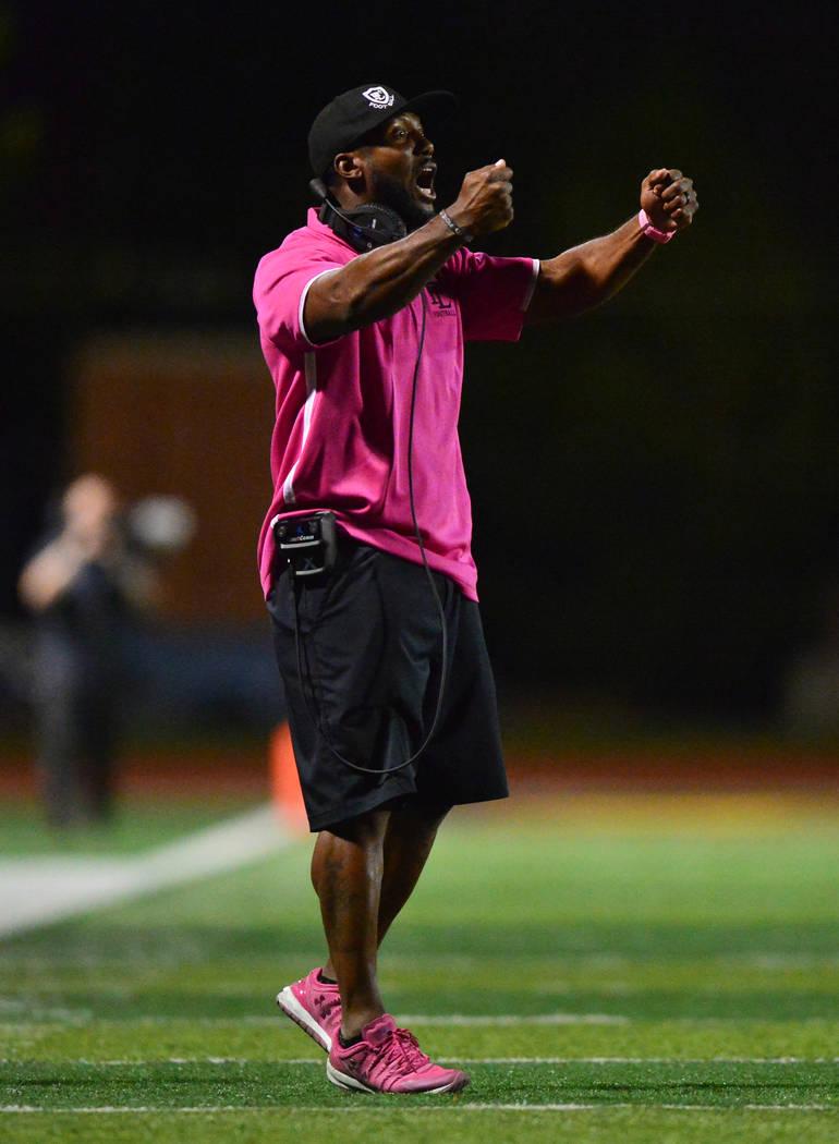 Faith Lutheran head coach Vernon Fox talks to his team during a game against Arbor View at Fait ...