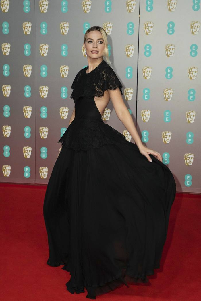 Actress Margot Robbie poses for photographers upon arrival at the Bafta Film Awards, in central ...