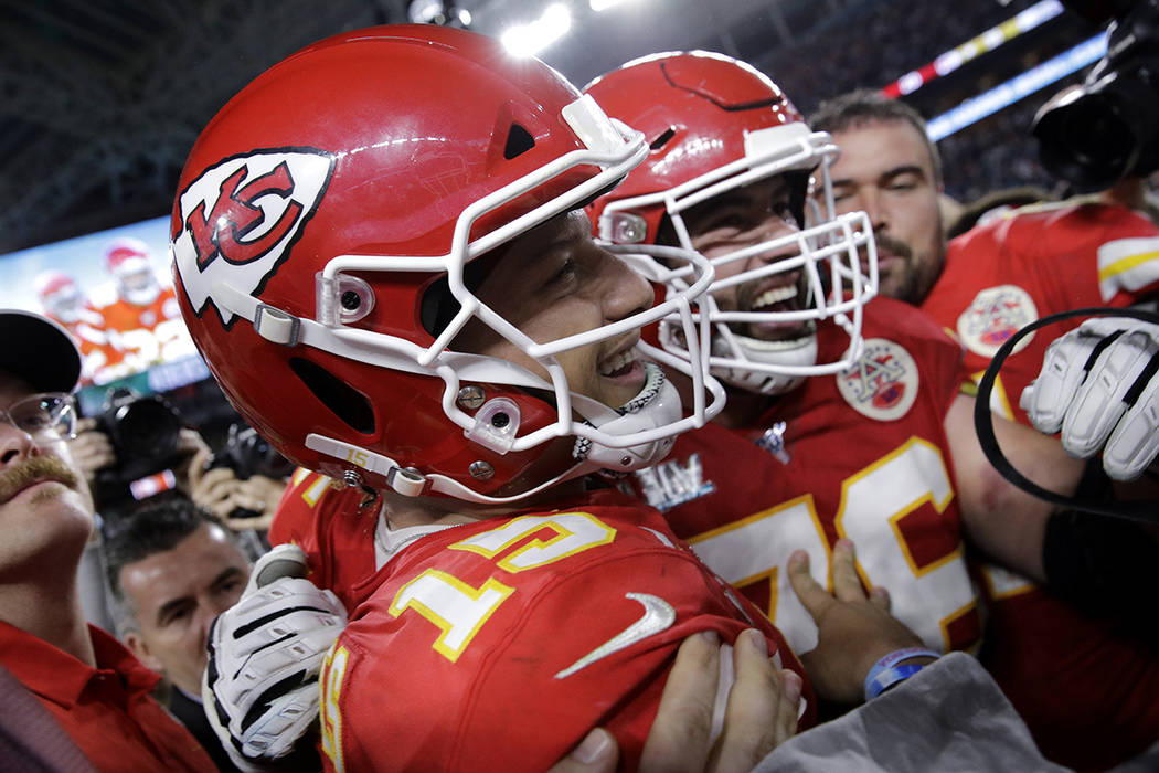 Kansas City Chiefs quarterback Patrick Mahomes (15) celebrates after the NFL Super Bowl 54 foot ...