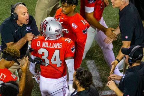 UNLV Rebels head coach Tony Sanchez, left, congratulates running back Darran Williams (34) on h ...