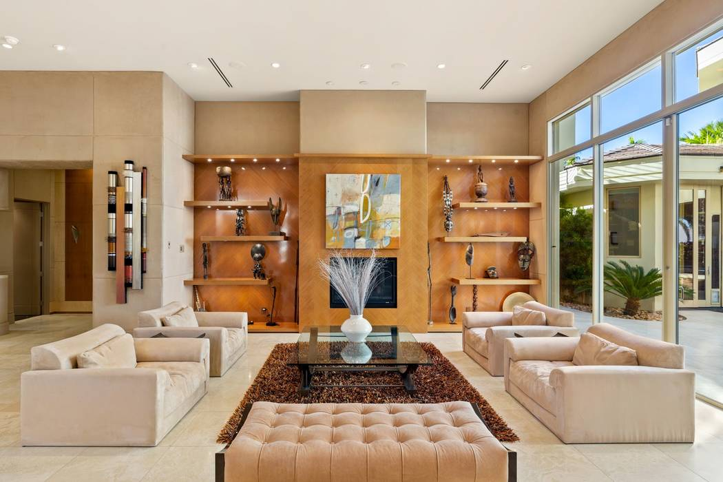 The living room features custom built-in cabinets. (Ivan Sher Group)