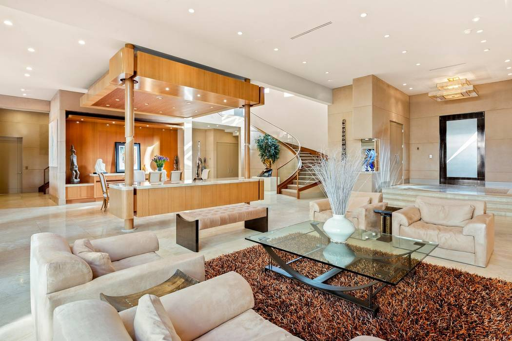 The living room is adjacent to the dining room. (Ivan Sher Group)