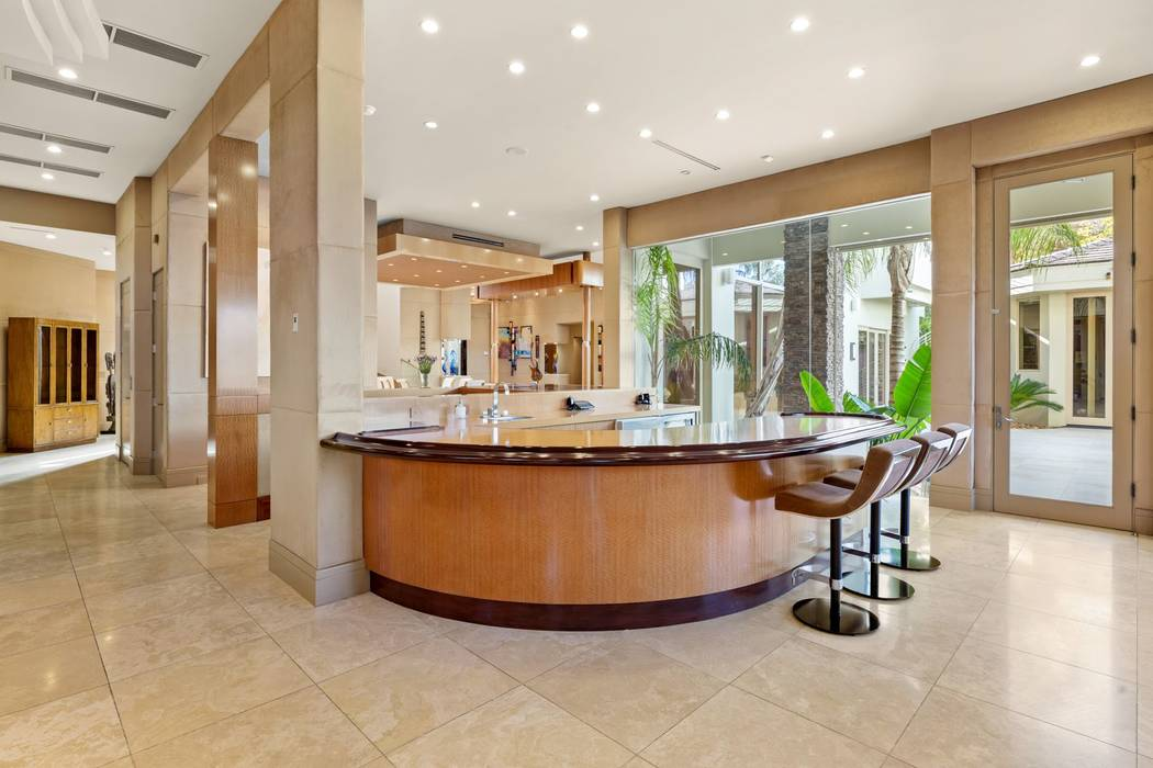A circular island is near the kitchen. (Ivan Sher Group)